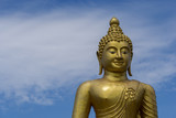 Golden Buddha Statue in Phuket; Thailand with blue sky background