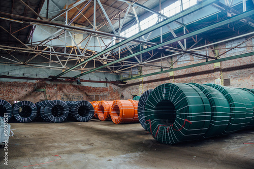 Warehouse of twisted rubber tubing of industrial hoses Poster