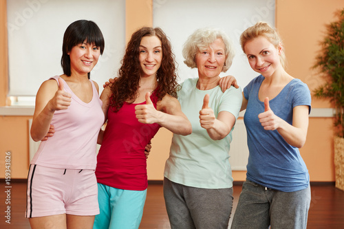 Group of women holding thumbs up