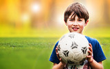 Young boy holding a soccer ball - 159409423