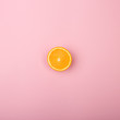 fresh orange slice on pink background - 159414476