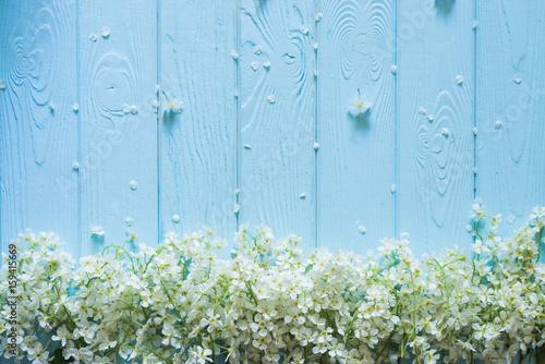 Naklejka Spring nature background white blossoms on blue pastel wooden planks. Floral concept