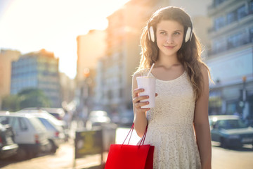 Young girl doing shopping in the street