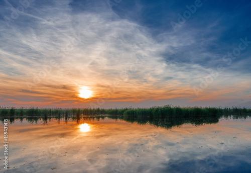 Plagát Sunset over lake