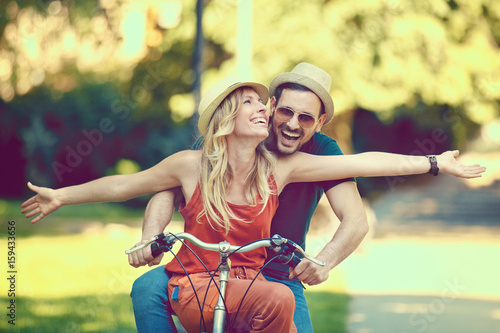 Happy Couple Riding a Bike
