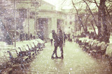 young man and woman in the snow in a city park couple winter - 159443250