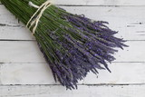 Bunch of lavender on white wooden background