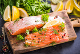 Salmon fish raw fillets on board with herbs - 159452266