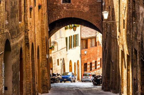 Old street in medieval Siena, Tuscany, Italy.