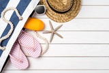 Beach accessories on white wooden table. Summer background