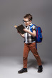 Little child with school bag reading a book - 159490219