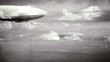 Постер, плакат: Legendary huge zeppelin airship on sky with clouds Black and white retro stylization old film Flying balloon animation Big dirigible spinning propellers and rudder Long zeppelin rigid airship