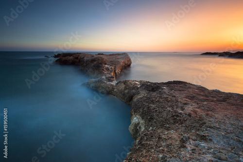 Beautiful long exposure seascape with sunrise or sunset.