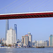 Bridge over Huangpu River with skyline on the background, Shanghai, China