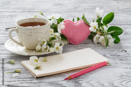 Love card in summer bouquet of gentle blooming apple and tea in china teacup Poster