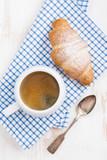 espresso and fresh croissant, vertical, closeup