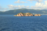 Small island off the coast of St. Thomas with clouds in the sky