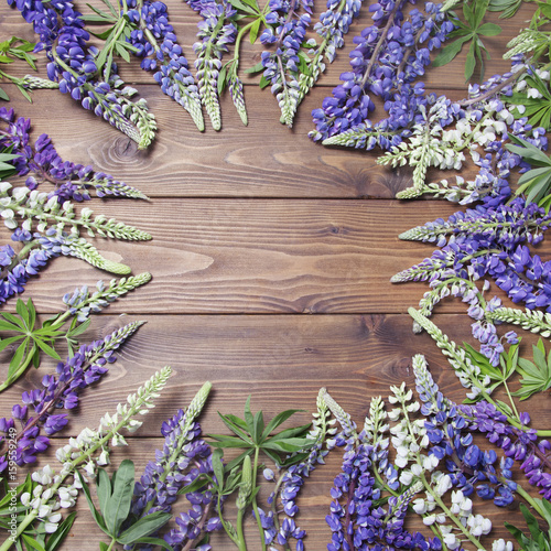 Wooden background with frame of lupine flowers Poster