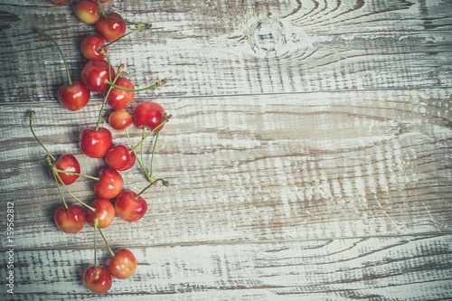 Red ripe cherry on a wooden background - 159562812