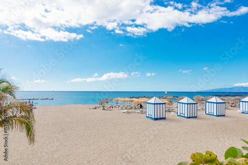 Tuinposter Canarische Eilanden Playa El Duque beach with tropical palm trees in Costa Adeje
