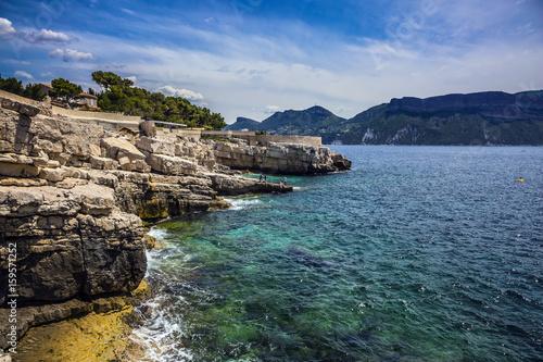 Abrupt stony coast and turquoise sea