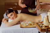 Young woman is put on a mask on her back in  spa salon. - 159589636