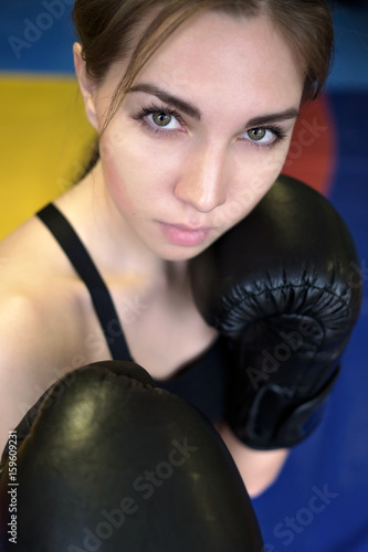 Póster Young adult sexy boxing girl posing with gloves.