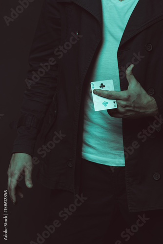 cropped shot of casual man holding playing card плакат