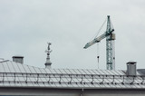 An angel statue with an arrow on the roof. Crane over a cloudy sky background.
