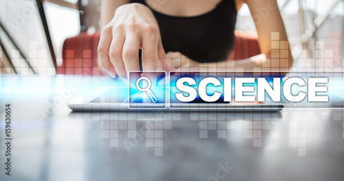 Woman using tablet pc and selecting science.