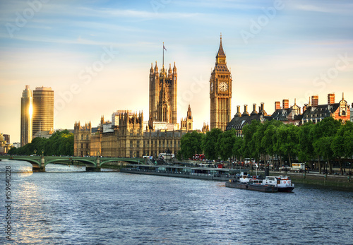 Big Ben and Westminster parliament in London, United Kingdom with sun reflection Poster