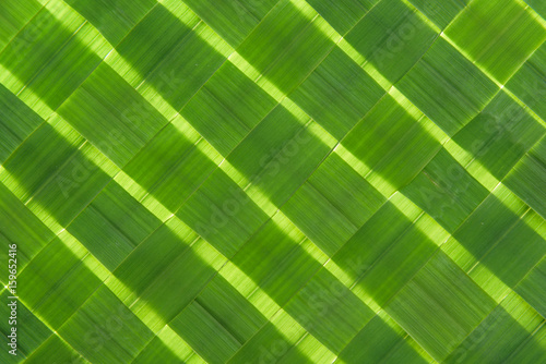Woven spring green grass as a pattern and texture background  - 159652416
