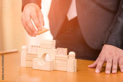 Businessmen construction building wood. Concept simulator wood. плакат