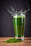 Young barley and chlorella spirulina, water splash. Detox superfood.. - 159654234
