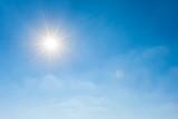 Sunny background, wonderful blue sky with bright sun