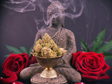 Zen background with roses and cannabis buds - medical marijuana and meditation concept