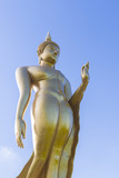 Buddha statue on blue sky background