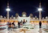 Visitors Entering Grand Mosque of Zayed in Abu Dhabi of Emirates at dusk