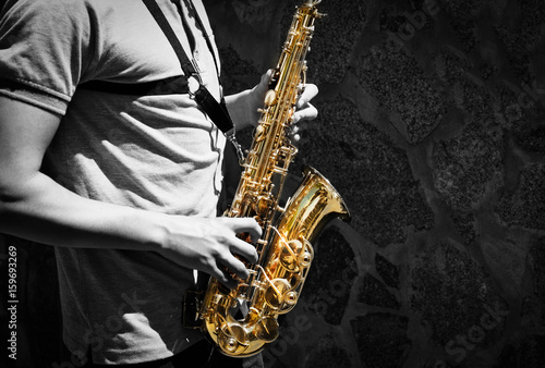 Man playing on saxophone Poster