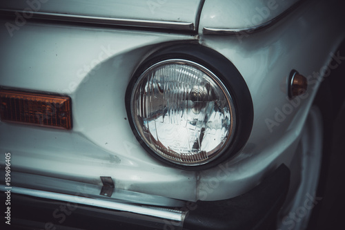 Foto op Canvas Stadion Headlights and body of an old classic car at an exhibition of vintage cars