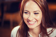 smiling happy young redhead woman face - 159743625