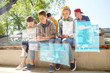 group of teenage friends with smartphones outdoors - 159750230