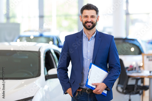 Car dealer in showroom