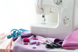 sewing machine, scissors, buttons and fabric - 159752631