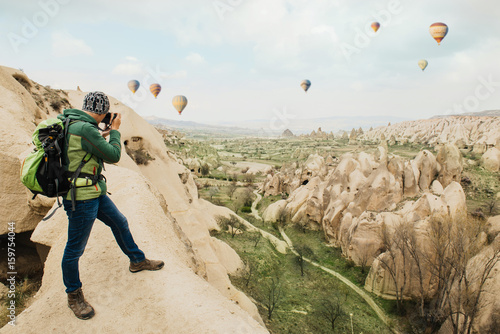 Tuinposter Canyon taking photos of rocky mountain landscape in Cappadocia