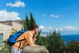 a young traveller looking at Naples from the terrace of the Certosa di San Martino - Campania, Italy