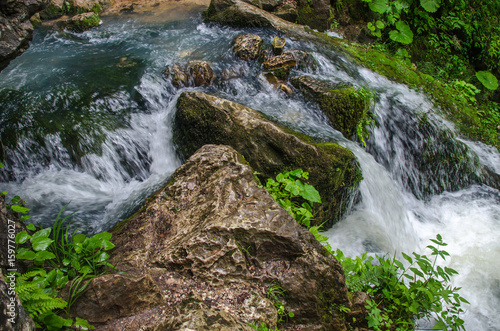 Beautiful wallpaper milk waterfall flow rapid stream. Caucasus rocky mountain river in forest. Isichenko waterfall, Guamka, Mezmay. - 159776027