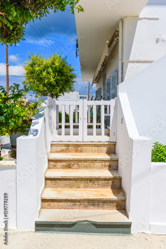 Typical Greek stairs and apartment in Pollonia town on Milos island, Cyclades, Greece
