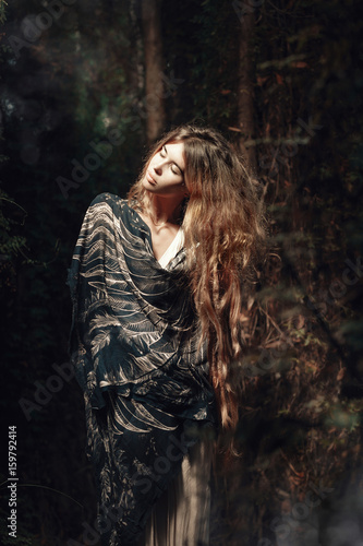 attractive young boho woman in mystery forest - 159792414