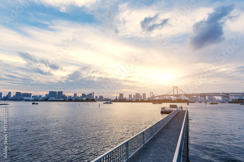 empty fishing dock with modern city near river